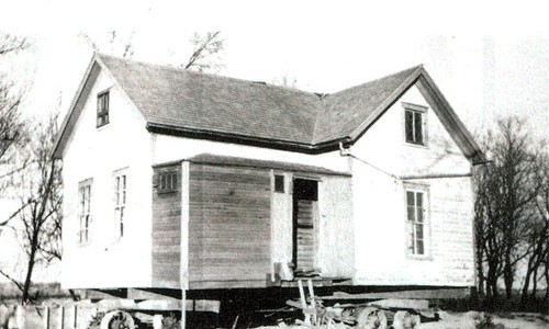 1937 - House being moved north of  Kerkhoven. Note steel wheel dollies